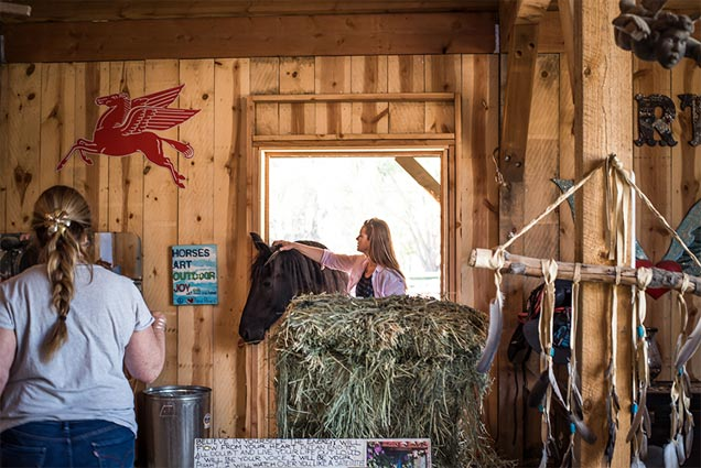 Ladies and Horse in barn